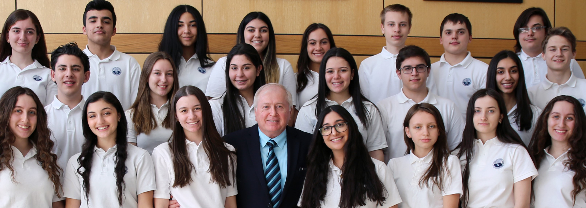 Dr. Hosep Torossian pictured with National Honor Society students
