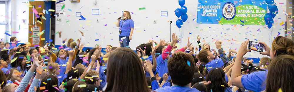 Students and staff at Eagle Crest Charter Academy celebrating at their National Blue Ribbon School Award assembly.